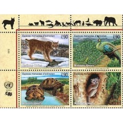E) 2001 UNITED NATIONS, ENDANGERED ANIMALS, TORTOISE, PEACOCK, BLOCK OF FOUR